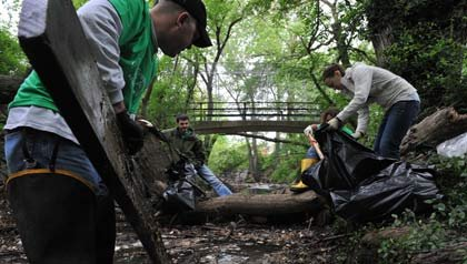 A small group of volunteers work to clean trash from the Watts Branch Stream.