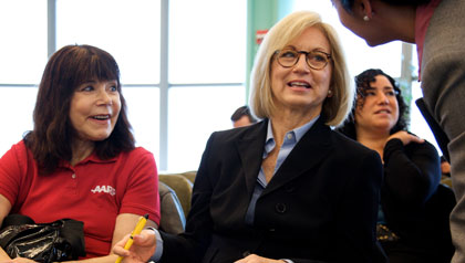 Susan Ryckman, one of AARP New York's 5,000 volunteers, at a health care forum at Baruch College.