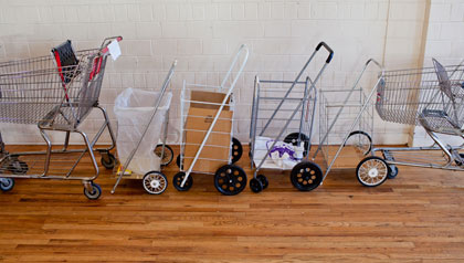Carts belonging to volunteers at the Senior High Rise Food Bank in Edgewater are lined up before grocery distribution begins.