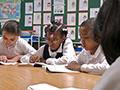 Children doing schoolwork, AARP Experience Corps In the News