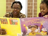 A woman reads to young girl, AARP Experience Corps Awards