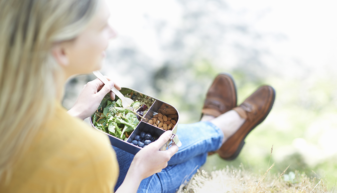 woman eating healthy lunch outdoors