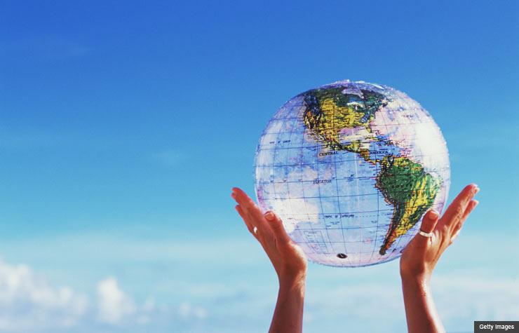Dan Buettner blue zones happiness world globe hands sky