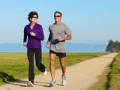 Smiling couple jogging on path, Exercise helps brain health