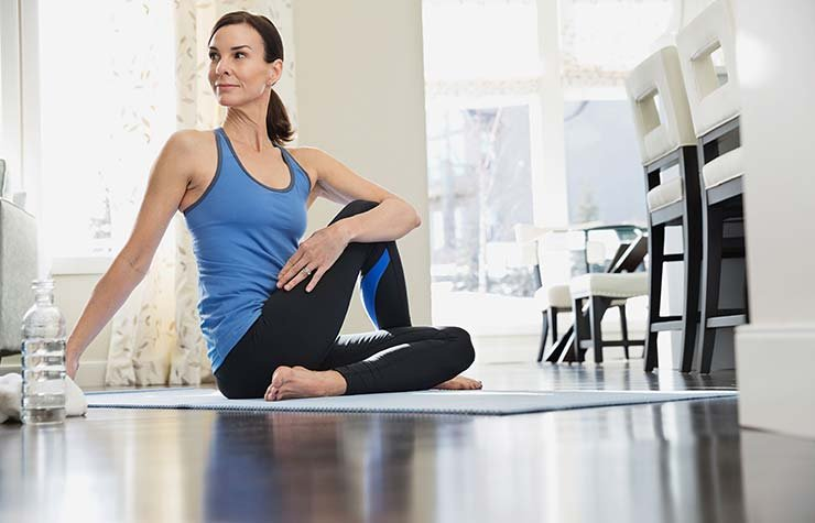 Woman practicing yoga. Exercise is key to de-stressing.