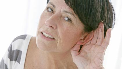 Woman cupping ear, Hearing loss and dementia (BSIP SA/Alamy)