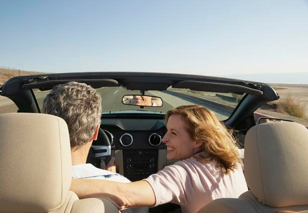 Couple in open convertible car, Socialization and brain health (Laura Doss/Corbis)
