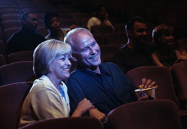 Couple watching movie in theater, Remembering movie title