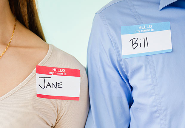 Man and woman wearing name tags, Remember names