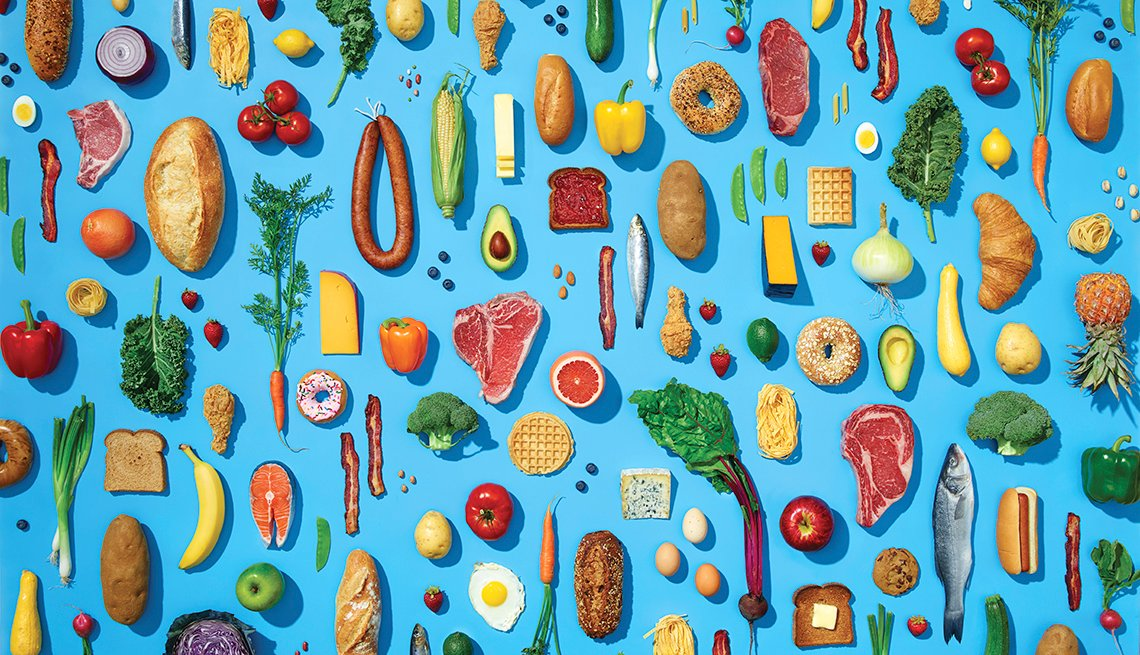 Various healthy foods in pattern on blue