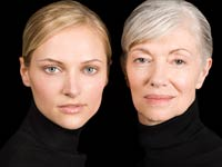 Young and senior woman against black background