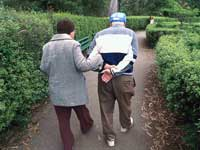 Couple walking - regular exercise counteracts risk for Alzheimers