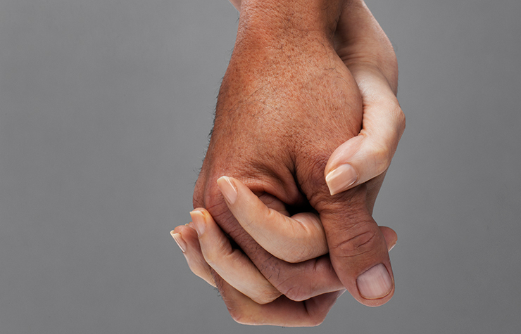Mature adults holding hands
