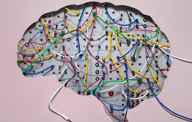 Grafico de un cerebro con cables conectores