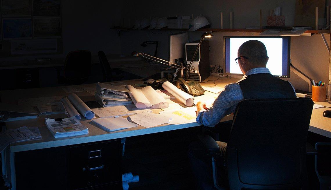 A man works in a dark room