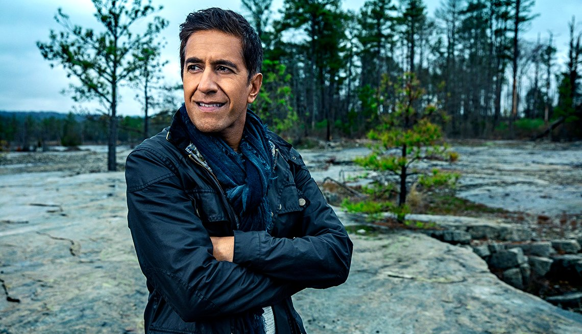 doctor sanjay gupta standing outdoors with arms crossed looking thoughtful