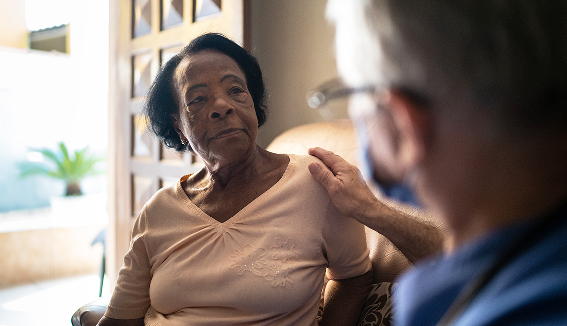 woman at home being seen by a visiting caregiver