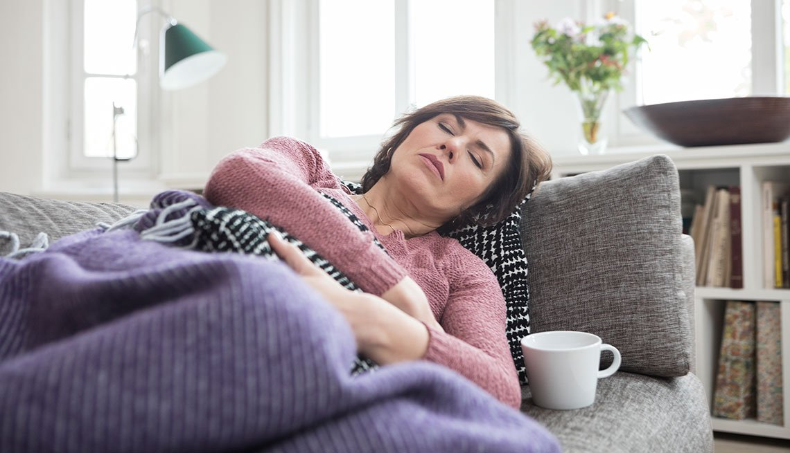 mature woman not feeling well taking a nap