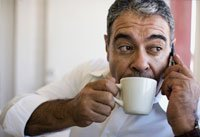 Man sipping coffee may reduce risk of skin cancer