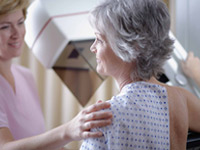 Woman receiving mammogram. Some experts recommend a new approach to screening for breast cancer based on personal risk factors.