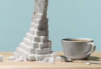 a cup of coffee and a pile of sugar cubes