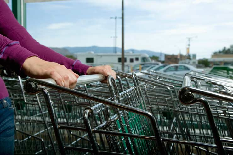 Woman selecting a shopping cart