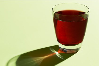 Foods that lower high blood pressure - glass of beet juice