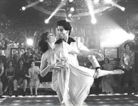 John Travolta and Karen Lynn Gorney in a scene from Saturday Night Fever.