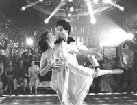 "John Travolta dances in ""Saturday Night Fever"""