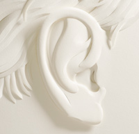 paper ear sculpture by Jeff Nikasaka – hearing aid guide