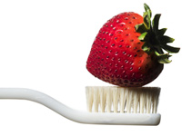 Strawberries may stain your clothes but not your teeth.