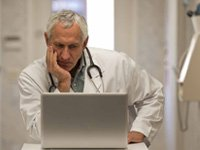 doctor looks at PSA test for prostate cancer study
