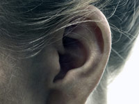 Woman's ear - Tips for Buying Hearing Aids.