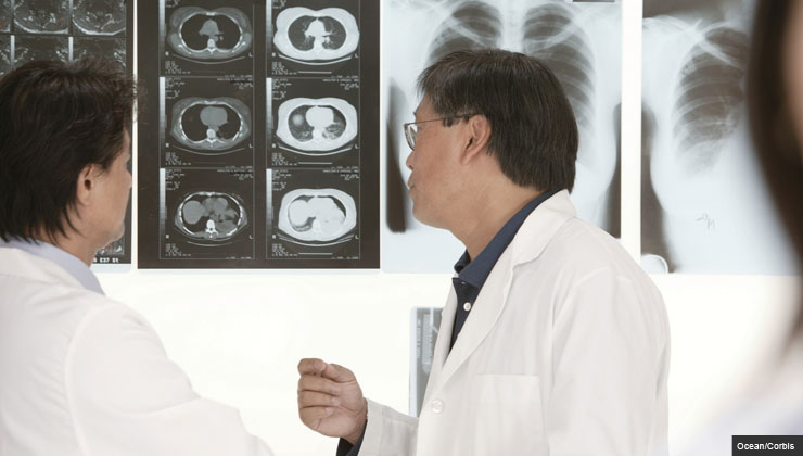 Doctors examine an x-ray