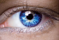 Close-up of woman's eye illustrates article on aging eyesight