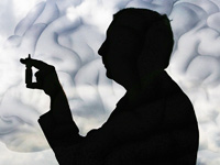 Silhouette of man with an insulin nasal spray that may delay memory loss from Alzheimer's disease.