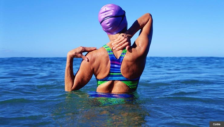 Woman stretching before a swim. Avoid or correct back pain without drugs