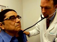 Doctor surveys Hepatitis C patient