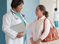 Doctor talking to woman, Skip annual Pap test