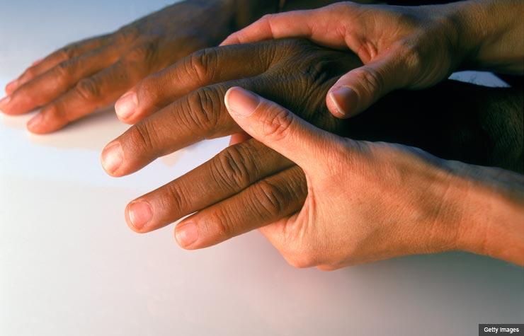 Hand massaging another hand, Understanding Osteoarthritis (Getty Images)