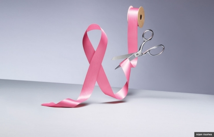 pink ribbon being cut by scissors (Adam Voorhes)