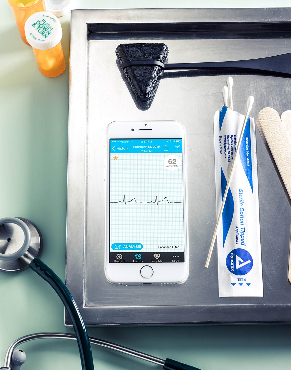 Doctors tools, including a smartphone with an EKG on it, Better Health Through Technology