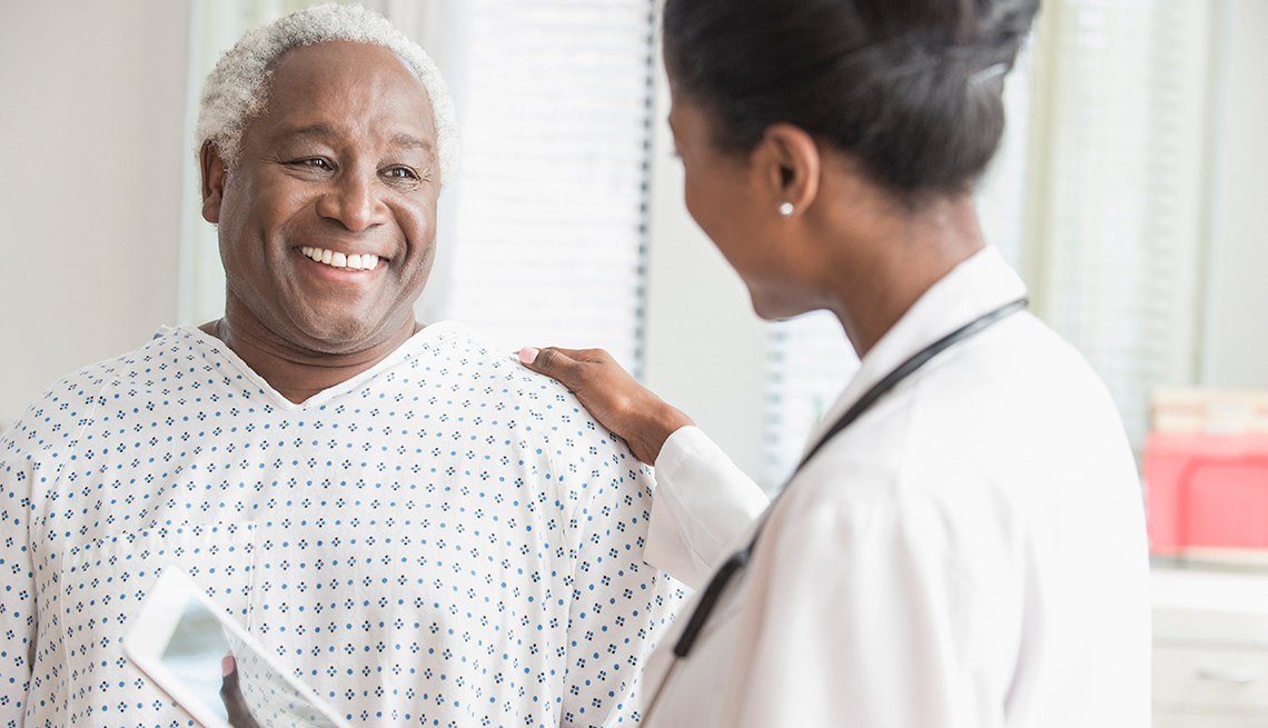 African American patient talking to the doctor