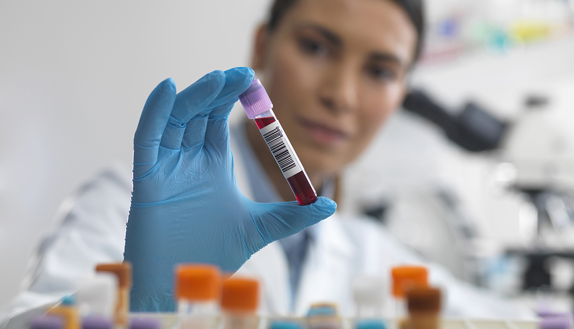 Nurse holding a blood test tube