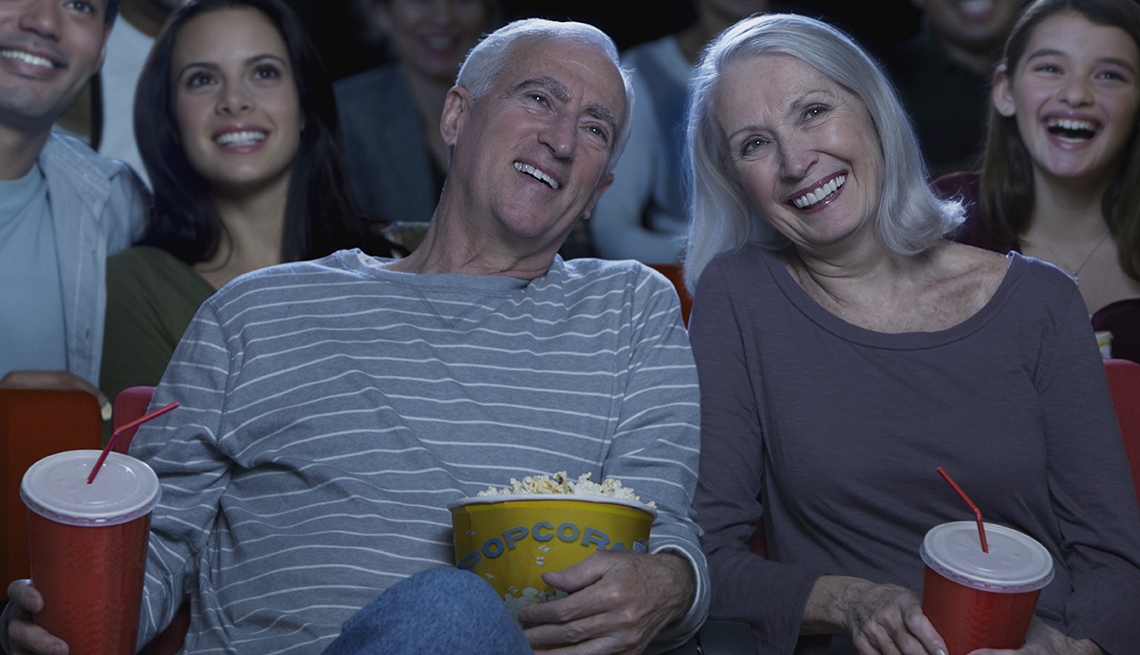Senior couple watching movies