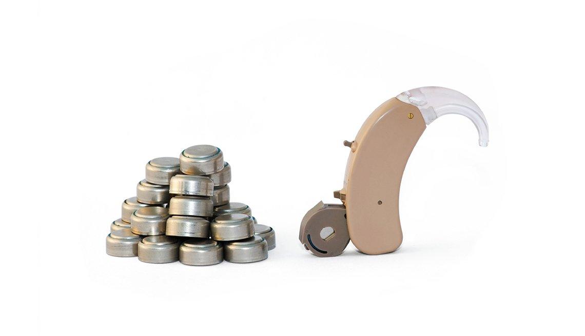 Baterias de audífonos y un audífono - Pérdida de audición