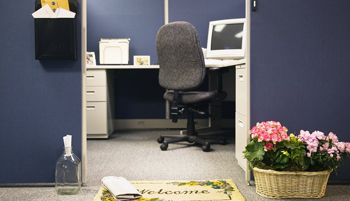 An office cubicle with flowerpots and welcome mat. Workplace Hearing Loss coping strategies