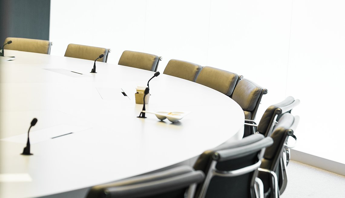 An office conference table, Workplace Hearing Loss coping strategies
