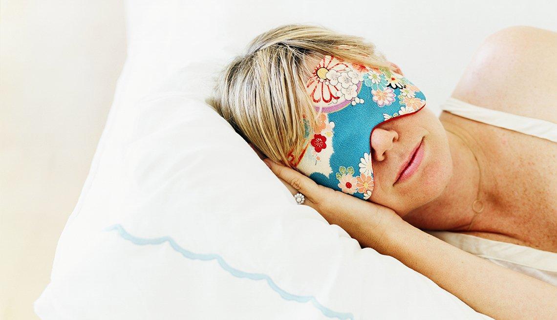 Woman sleeping in an eye mask, AARP Medical Advisory Panel: Brain Health and Sleep