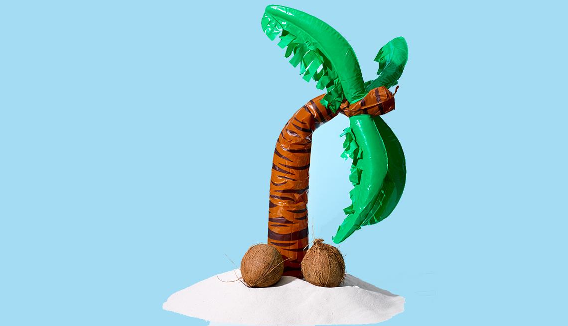 Figura de una palma de coco doblada y cocos en el suelo